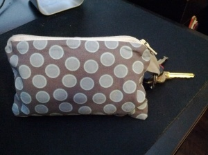"zippered fabric wallet, approximately 4"" by 6"", with attached key ring"